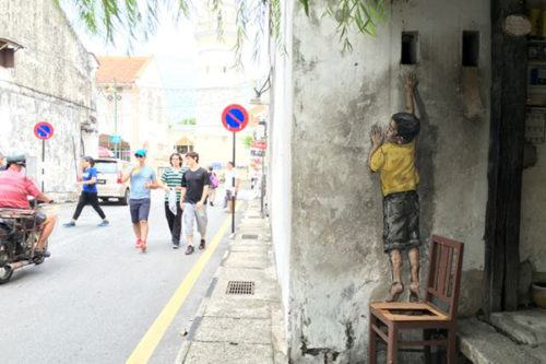 Top Attractions in Penang Penang Street Art Boy on Chair